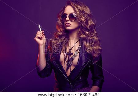 Portrait Of Elegant Blonde Woman In Glasses Smoking A Cigarette