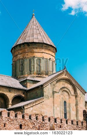 Mtskheta, Georgia. Close View Of Cross-Dome Svetitskhoveli Cathedral Of The Living Pillar, Georgian Orthodox Church, Blue Sky Background. Unesco Heritage, Famous Landmark.