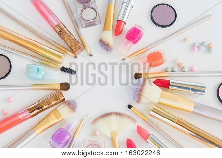 Colorful make up flat lay close up scene on white background