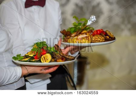 vegetables and chicken cooked on the grill.