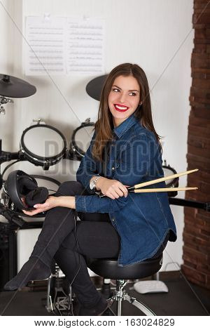Woman Drummer Practicing  At Home