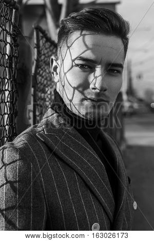 Handsome Man In Fashion Jaket In Black And White Image