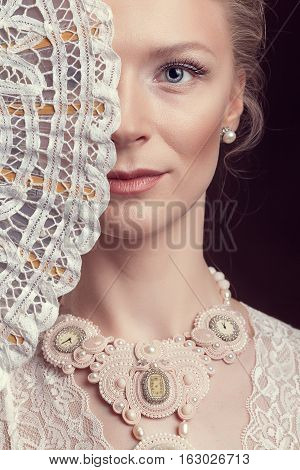 Portrait Of Woman Dressed In Victorian Style Holding A Fan