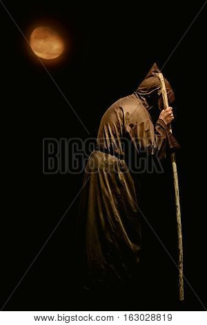 Image of Monk with a Stick at Night