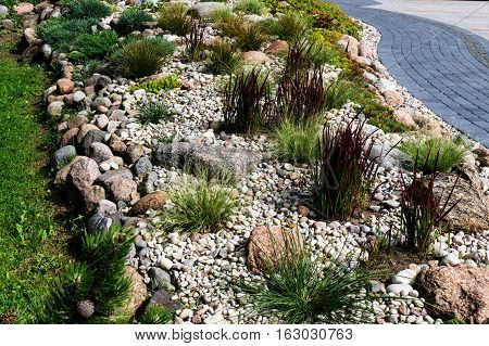 Natural stone landscaping in beautiful home garden