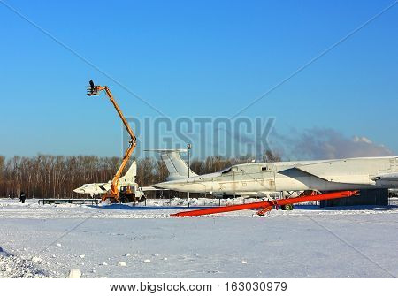 Repair works at a military airfield in winter day