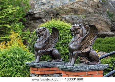 Buki landscape park bridge with griffons. In the spring garden.
