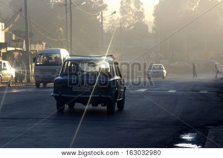 A silhouette of a taxi on streets of Addis Ababa, Ethiopia, february 2015