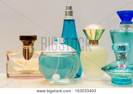 Perfume bottles of various shapes, sizes and colors.