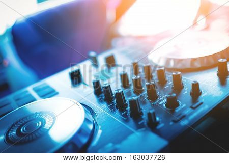 DJ console cd mp4 deejay mixing desk in nightclub