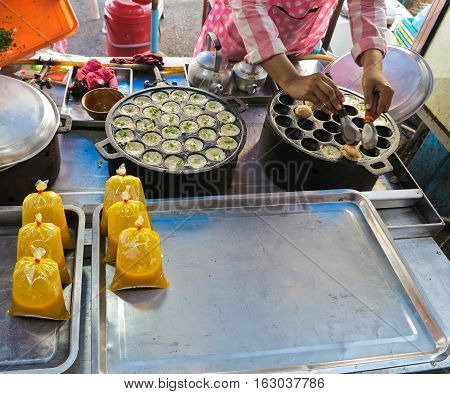 Kind of thai sweetmeat, Sweet and Savory Grilled Coconut-Rice Hotcakes it's for kanom krok but sometiems they use Coconut Rice Cake,Thai Coconut pudding too poster