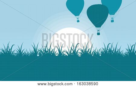 Silhouette of balloon with grass scenery vector art