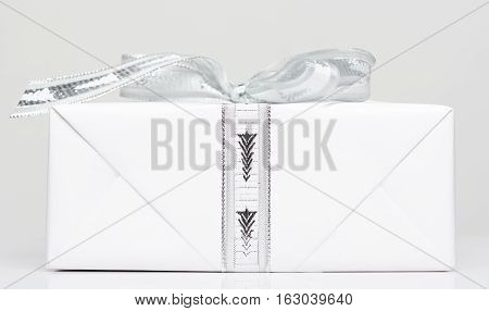 White package box with ribbon view from side profile