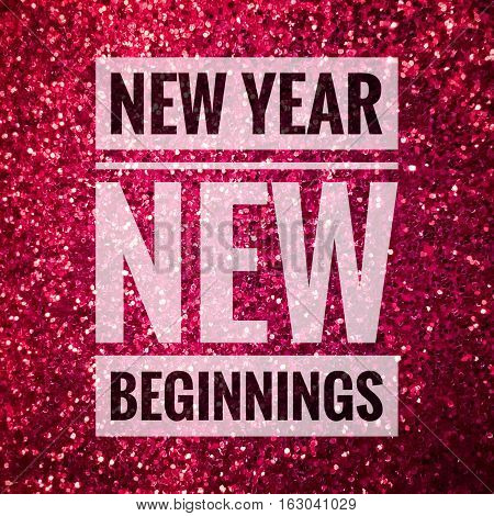 New year new beginnings words on shiny pink glitter background