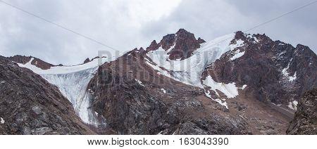 Panoramic view behind Talgar Pass in Tien Shan mountains. Peaks with glaciers Almaty Kazakhstan 2016