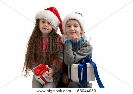 little children in costume holding boxes with gifts. New Year. Merry Christmas