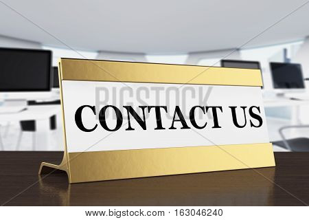 Golden Contact Us Plate on a wooden table. 3d Rendering