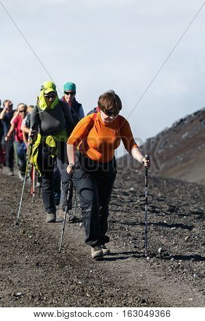 AVACHA VOLCANO KAMCHATKA PENINSULA RUSSIA - AUGUST 7 2014: Hiking on Kamchatka - group of women tourists and travelers climbing on tourist trail to top of Avachinsky Volcano.