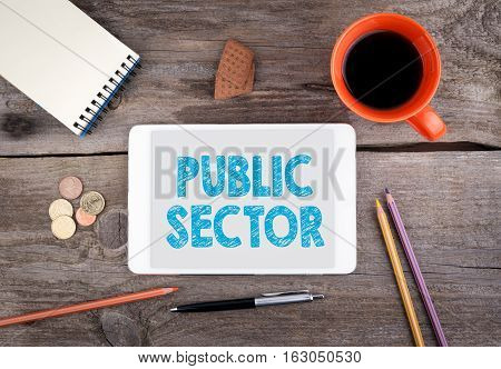 Public Sector. Text on tablet device on a wooden table