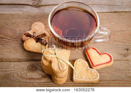 Cookies-hearts Related Together And A Cup Of Tea
