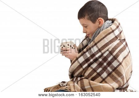 sick sad little boy wrapped in a blanket. Seasonal flu epidemic
