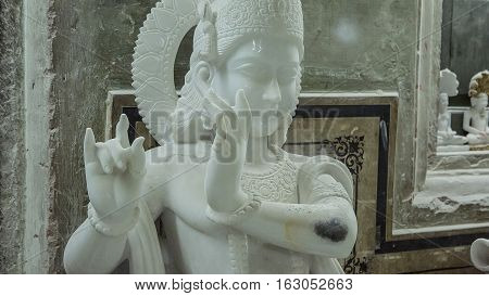 Statues of Hindu God Krishna Gopala Crafts and Arts of India. Murti handmade Manufacturing in Jaipur (Rajasthan). Indian God sculpture made of white marble. Ancient Traditions and Crafts of India