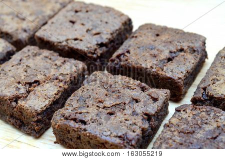 Delicious and soft fresh homemade brownie chocolate square and sliced on wooden board