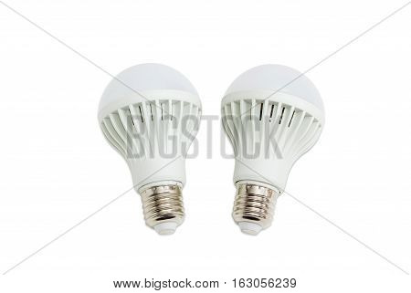 Two domestic light emitting diode lamp with a sized E27 male screw base on a light background