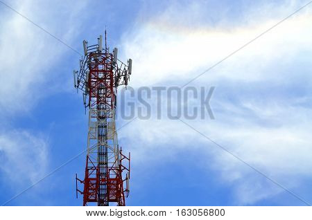 Telecommunication tower against blue sky day, technology concept