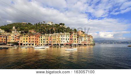 The harbor of Portofino with boats and the colorful houses. Genova Liguria Italy
