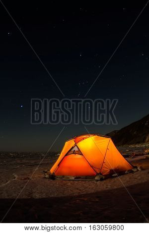 Yellow Tent At Night On The Shore Of Lake Baikal In Winter