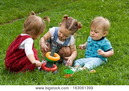 group of young children spending time in nature. summer