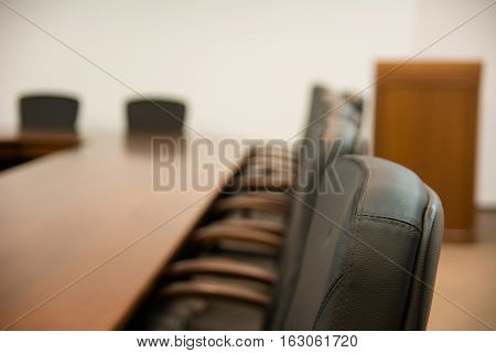 Back Of Chair Around A Wooden Table
