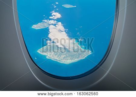 La Digue Island aerial view through aircraft windows in Seychelles - archipelago and country in the Indian Ocean. Visible Felicite and Marianne Islands.