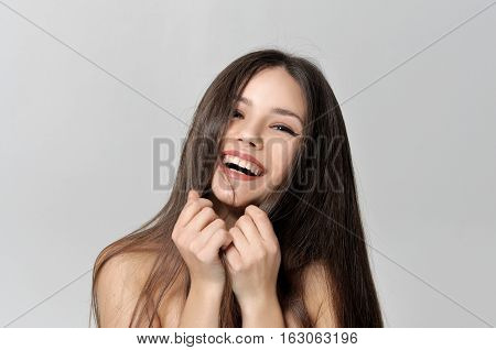 Laughing Woman Covers Her Face With Hair