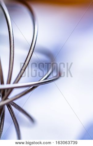 Stainless Steel Egg Whisk. Close up soft focus.