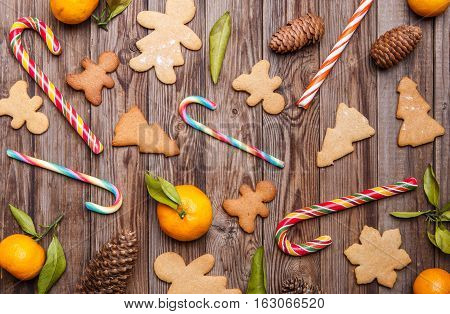 Christmas confection on wooden table decorated with tangerines