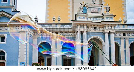 Big Soap Bubble With A Thousand Colors In Front Of The Cathedral Of Brixen