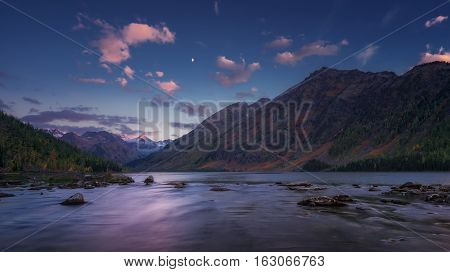 Mountain River View On Early Sunset With Blue Sky And Pink Clouds, Altai Mountains Highland Nature Autumn Landscape Photo. Beautiful Russian Wilderness Scenery Image.