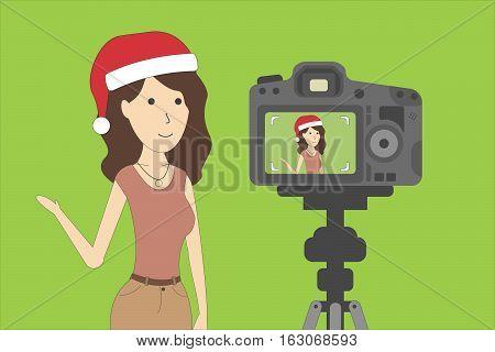 Christmas blog recording on chroma key background. Vlog. Video recording. Beautiful girl in santa hat.