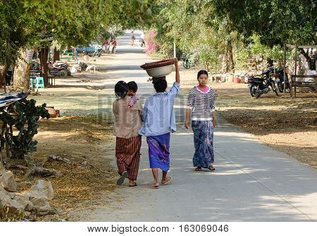 People Walking On Street In Yangon
