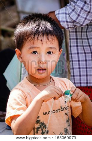 Burmese Boy Posing For Camera