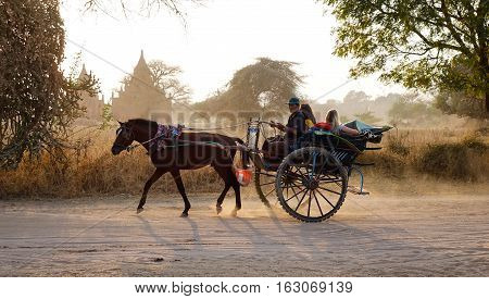 Burmese Man Riding Horse Cart On Dusty Road
