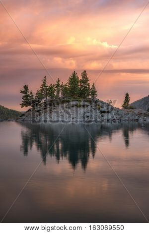 Rocky Island With Pine Trees On The Mountain Lake At Sunset, Altai Mountains Highland Nature Autumn Landscape Photo. Beautiful Russian Wilderness Scenery Image.