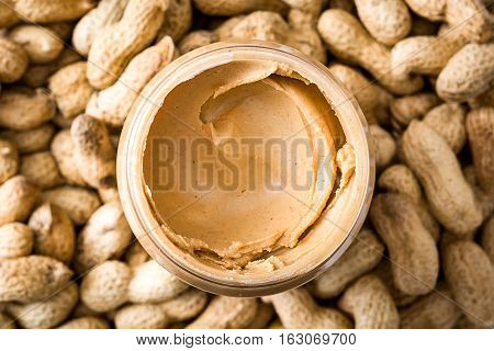 Creamy peanut butter on peanut background. Overview