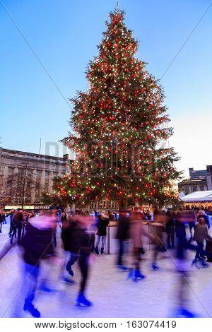 NOTTINGHAM ENGLAND - DECEMBER 22: Nottingham Christmas tree and ice rink at Nottingham Christmas market. In Nottingham England. On 22nd December 2016.