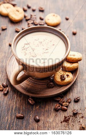 Coffee with milk and cinnamon. Food background