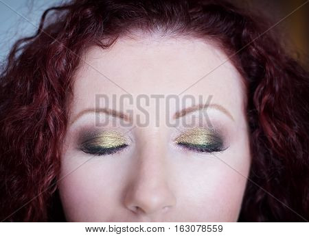 Professional makeup on closed eyes close-up shot