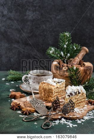 Honey cake with spices and Christmas decoration on dark background. Festive sweet food