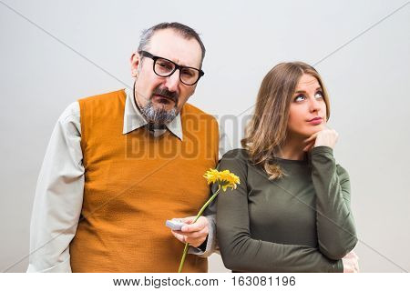 Nerdy man wants to marry to a beautiful woman,but she is not interested.